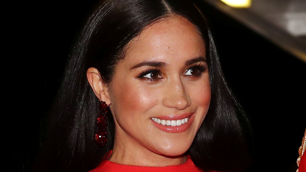 Meghan Markle smiles during a public outing