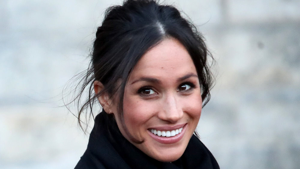 Meghan Markle smiling for the cameras
