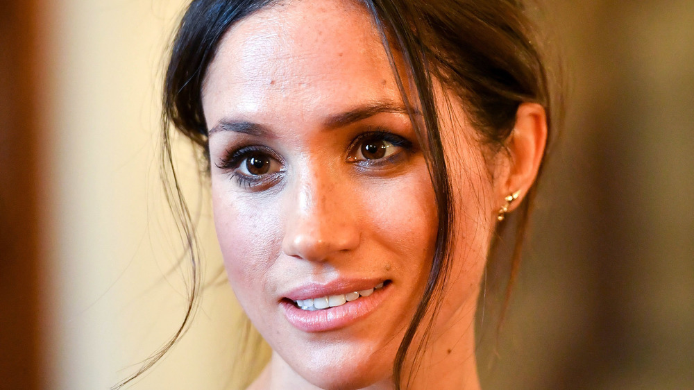 Meghan Markle gives a pensive look while on royal duties