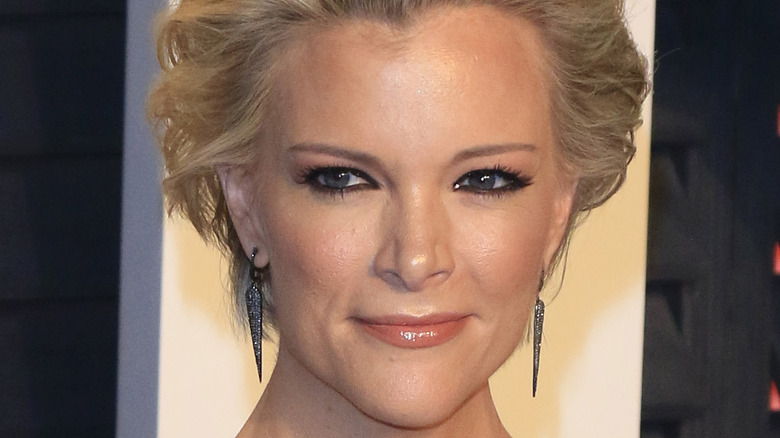 Megyn Kelly smiling and looking to the side