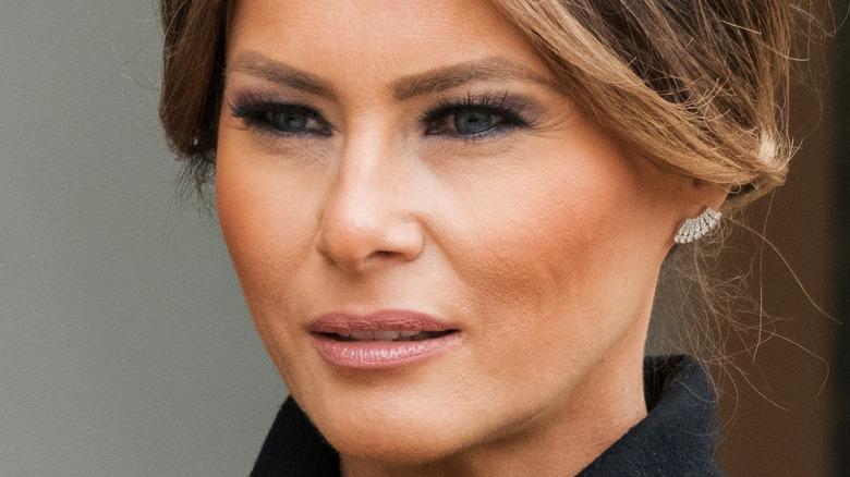Melanie Trump with a neutral expression