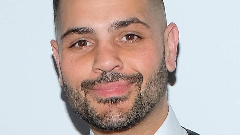 Michael Costello smiling on the red carpet