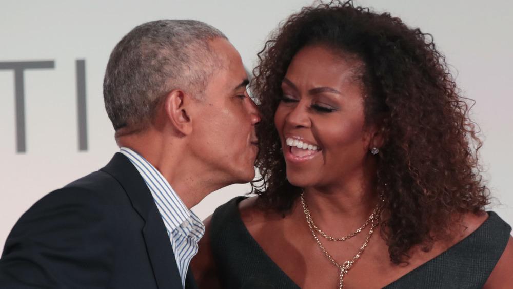 Barack Obama kisses Michelle Obama