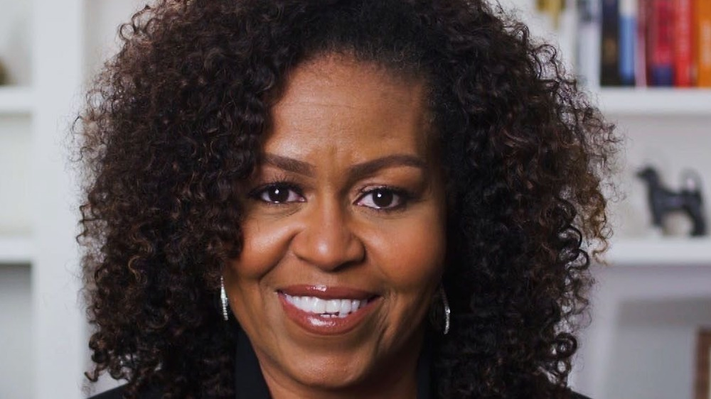 Michelle Obama smiling at the camera
