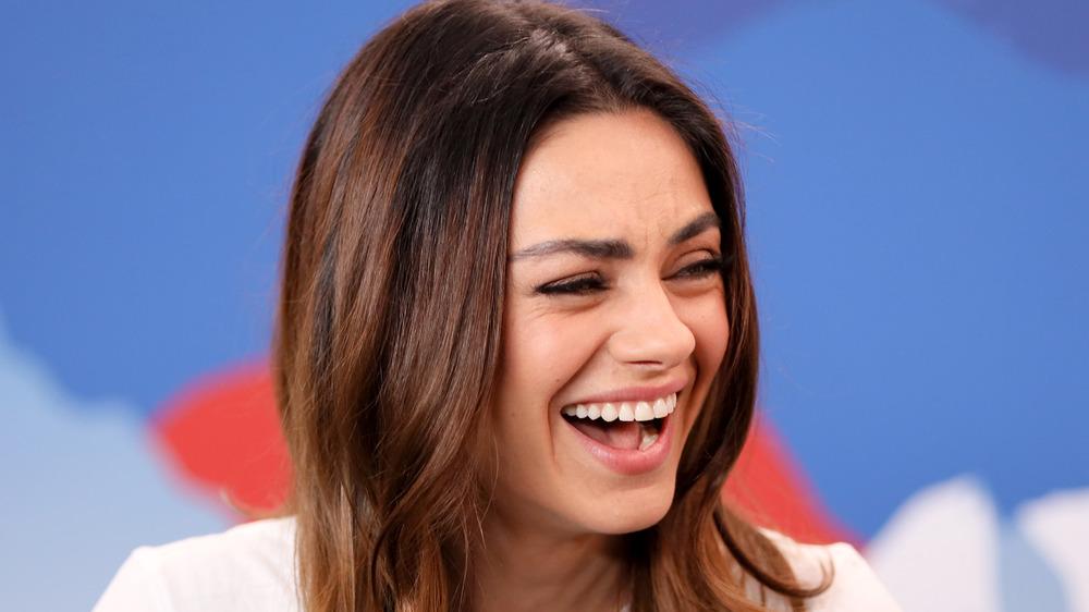 Mila Kunis laughing