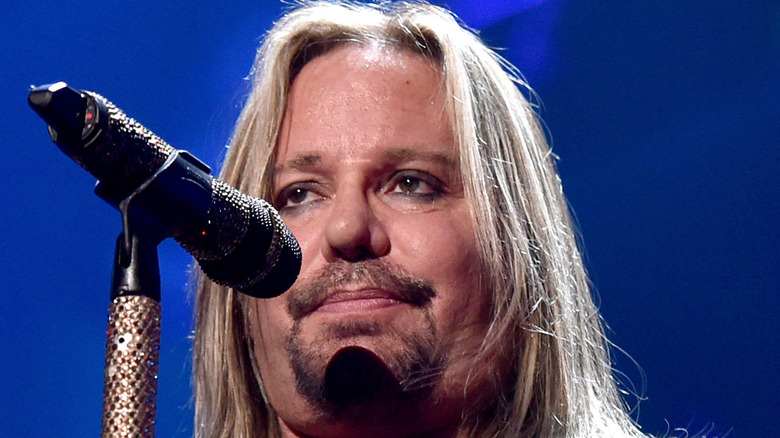 Vince Neil in front of a microphone
