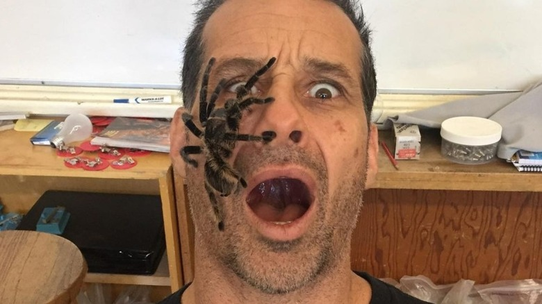 Gary Golding of Naked and Afraid XL with at huge spider on his face