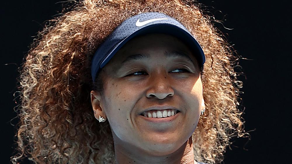 Naomi Osaka smiling after win