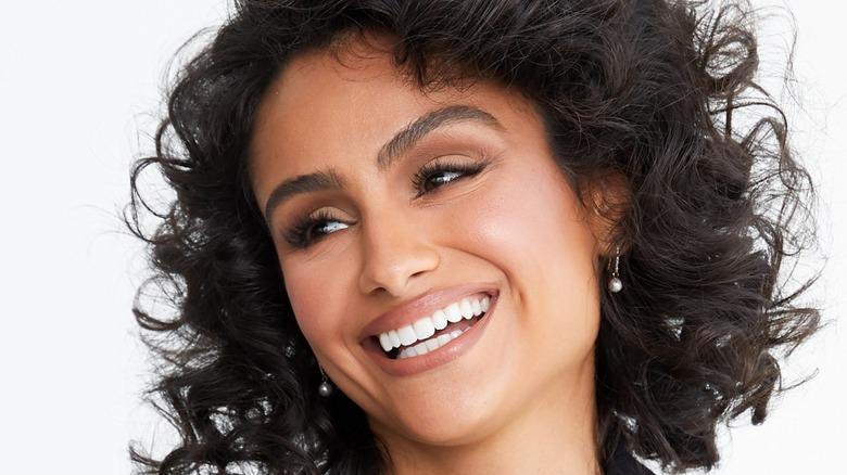 Nazamin Mandi smiling wide