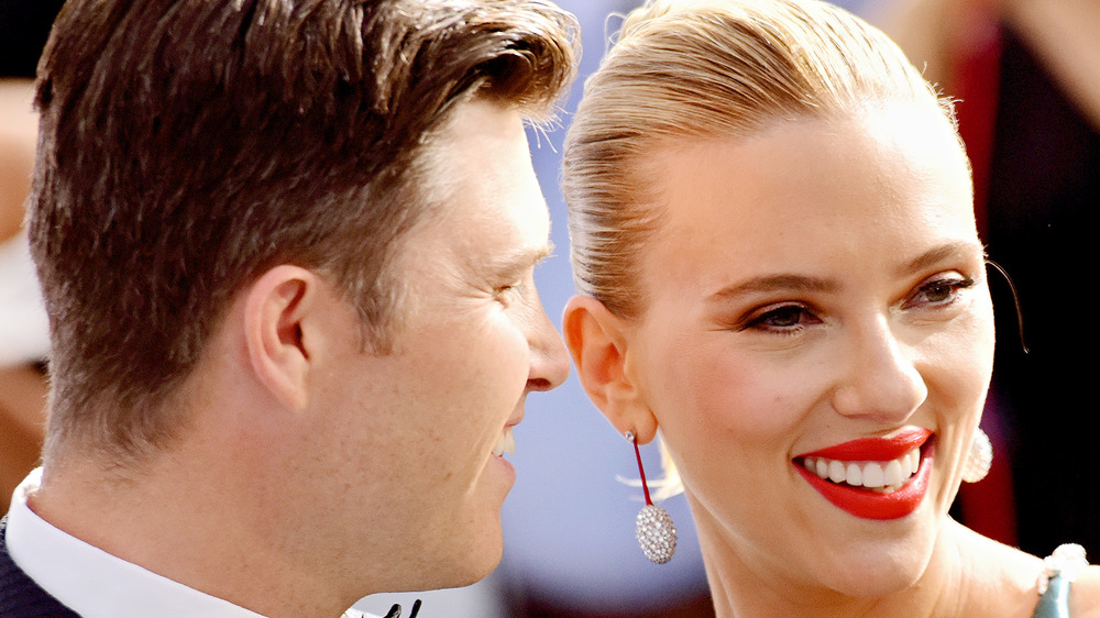 Colin Jost and Scarlett Johansson posing together
