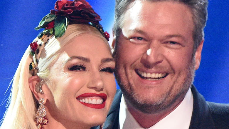 Gwen Stefani and Blake Shelton pose onstage during the 62nd Annual GRAMMY Awards