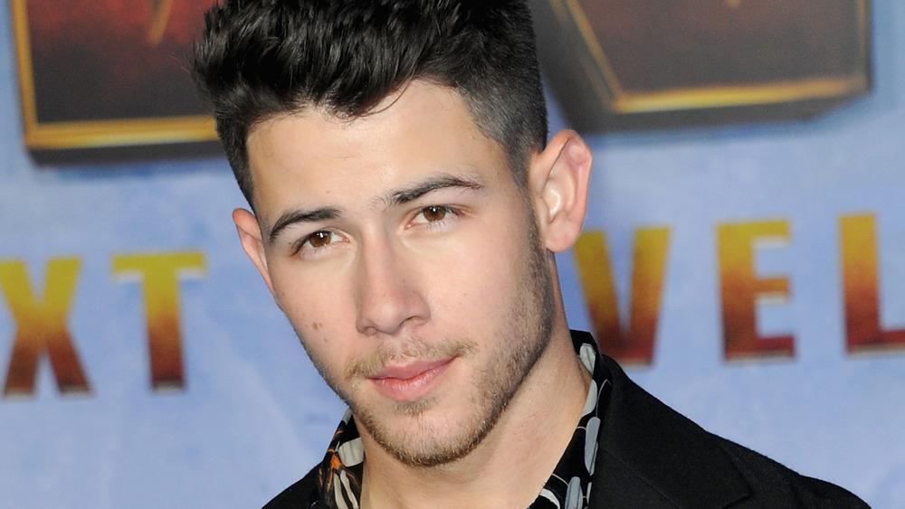 Nick Jonas posing on the red carpet