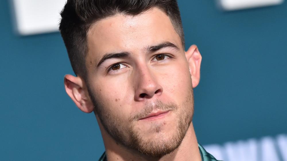 Nick Jonas tilting head