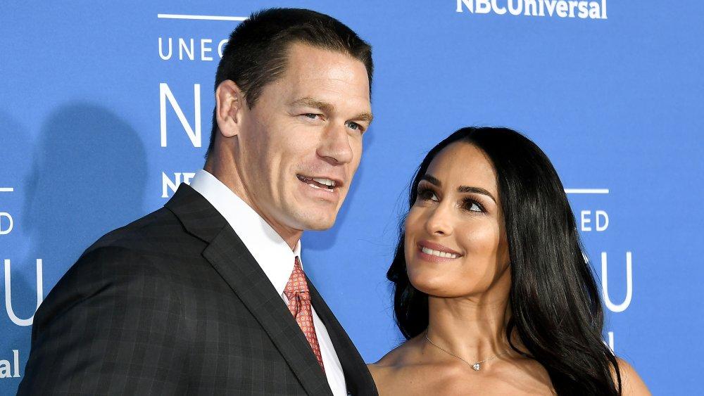 Nikki Bella looking up at John Cena on the red carpet