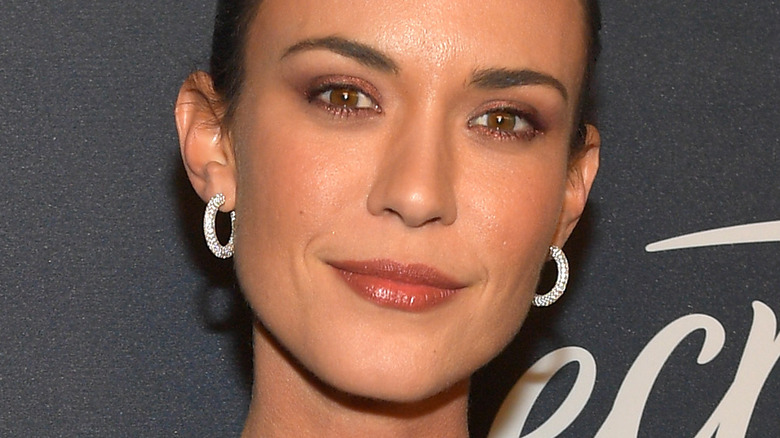 Odette Annable posing at a red carpet event