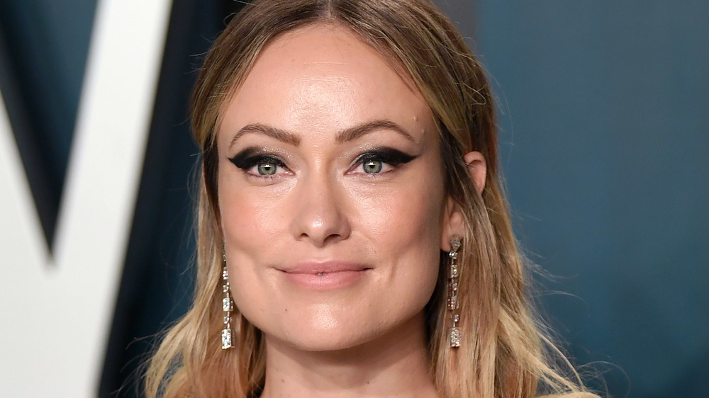 Olivia Wilde posing at an event