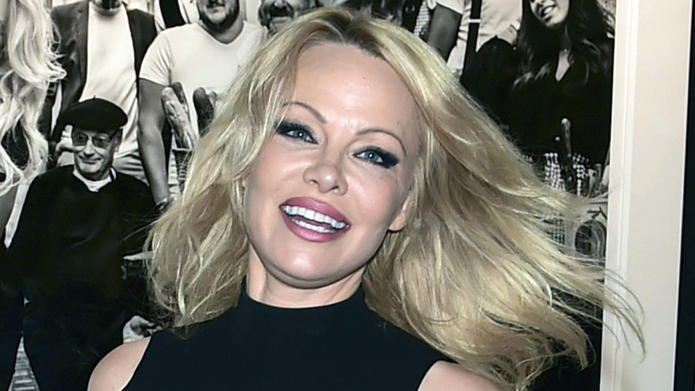 Pamela Anderson posing at a Hollywood event