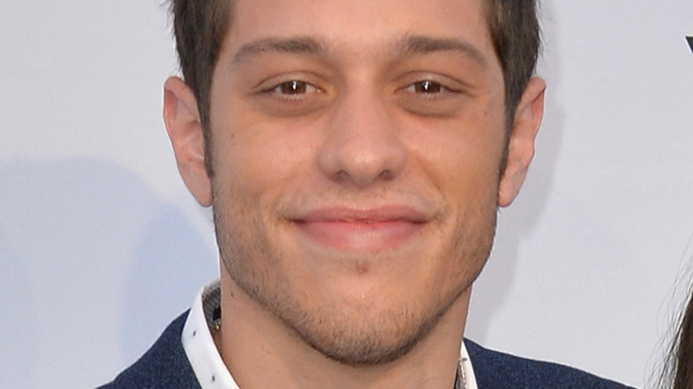 Pete Davidson smiling on the red carpet