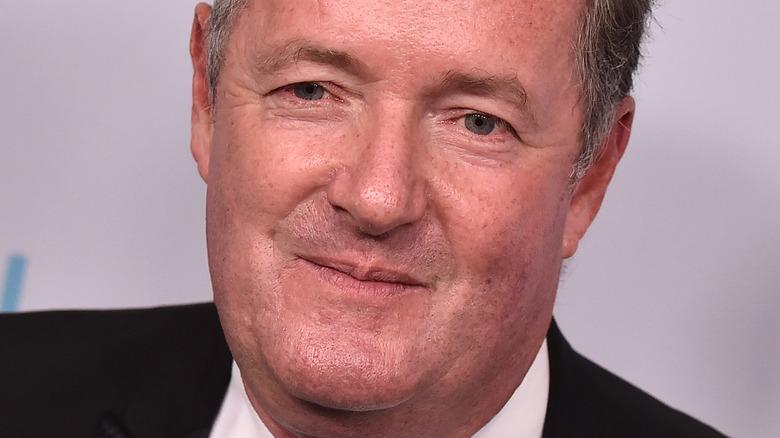Piers Morgan posing on the red carpet