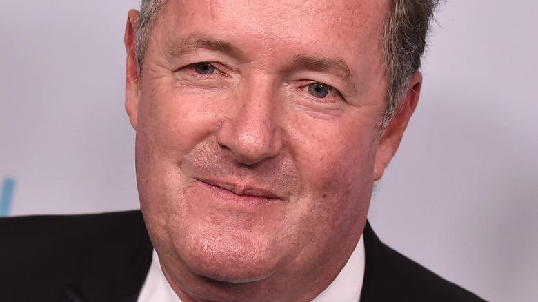 Piers Morgan posing for the cameras