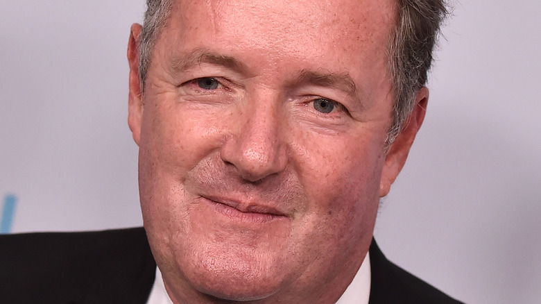 Piers Morgan grins on the red carpet