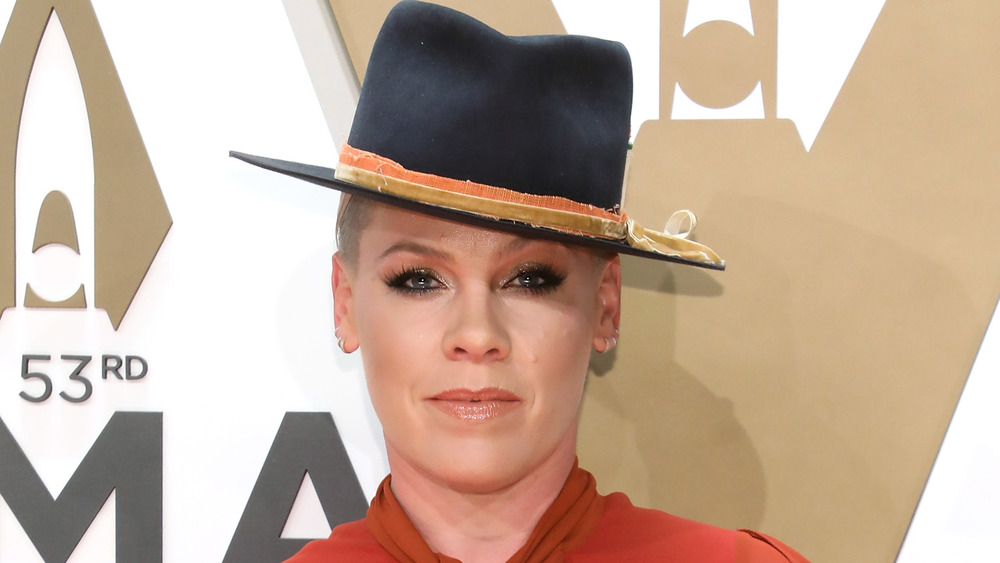 Pink poses on the red carpet for an event