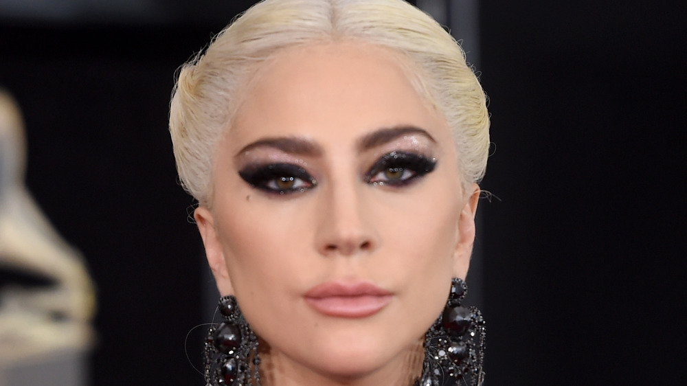 Lady Gaga strikees a fierce pose on the red carpet