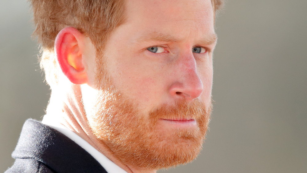 Prince Harry appears somber in a photo