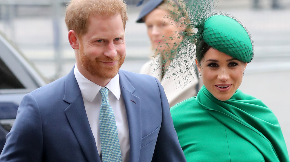 Prince Harry with Meghan Markle at an event