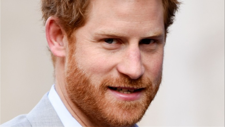 Prince Harry baring teeth