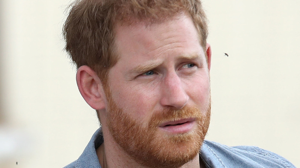 Prince Harry with a serious expression