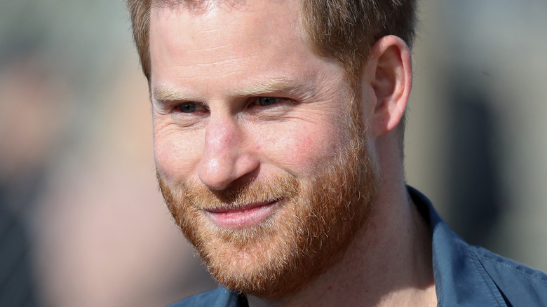 Prince Harry smiling for the cameras
