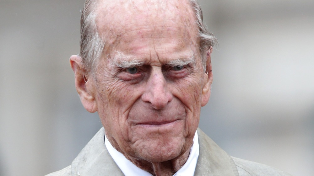 Prince Philip gives a slight grin when he was at a public event