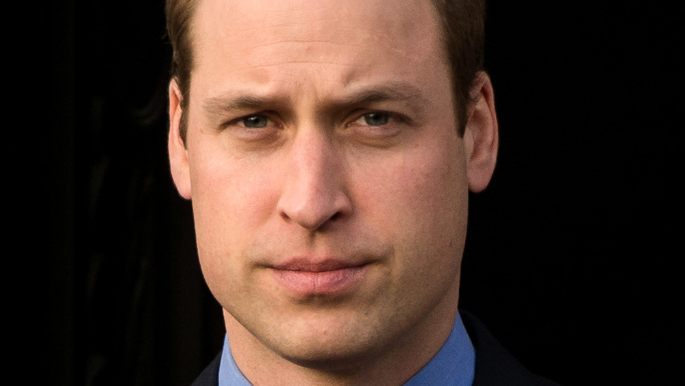 Prince William looking at the cameras with a furrowed brow