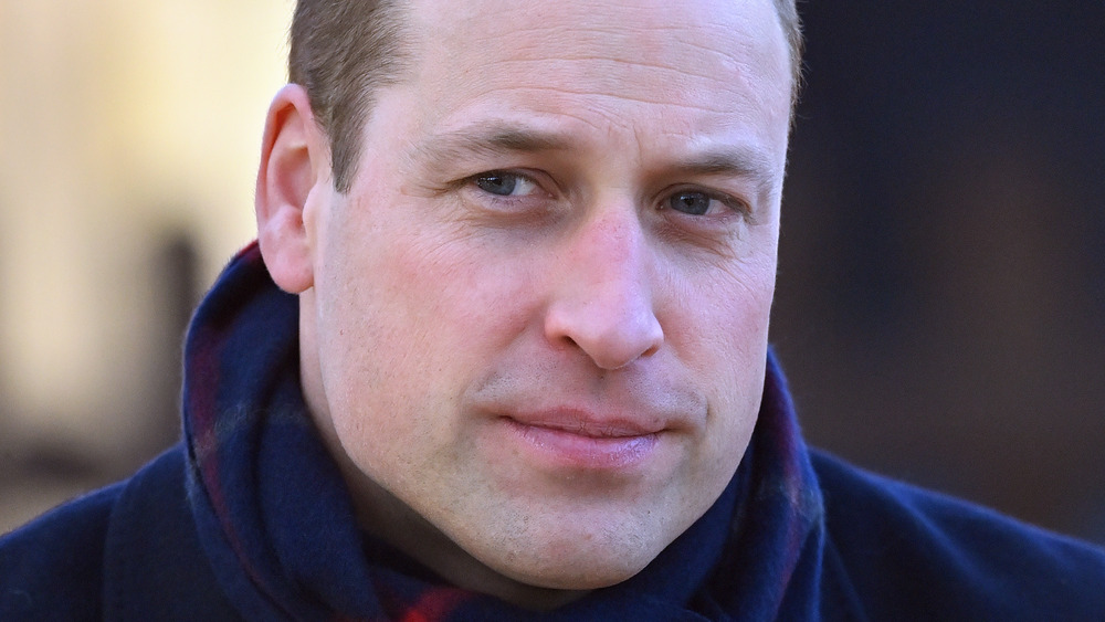 Prince William with a neutral expression