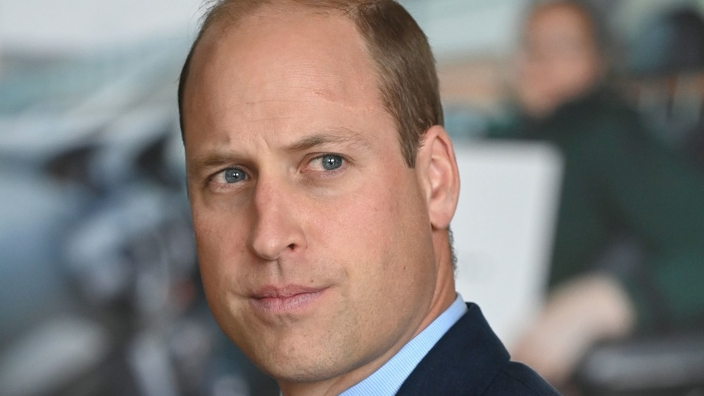 Prince William looks somber during a public outing
