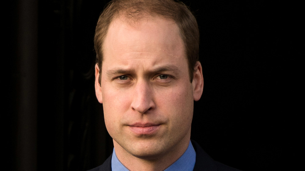 Prince William posing for a photo