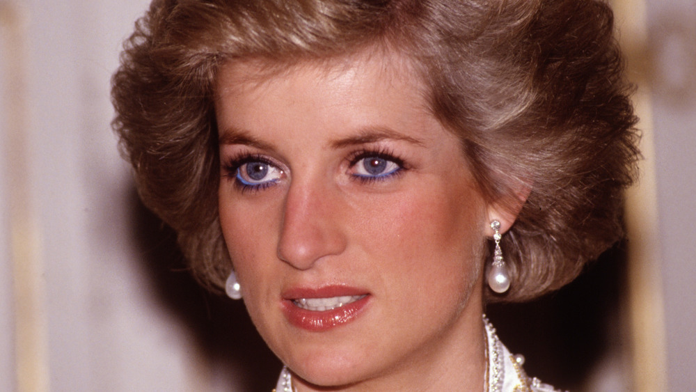 Princess Diana staring with a serious expression