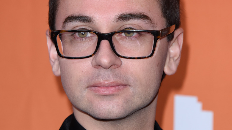 Christian Siriano looking to the side with serious expression
