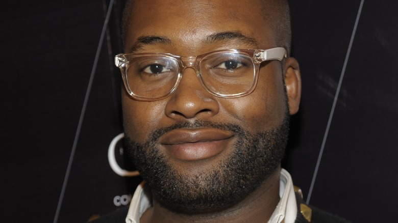 Mychael Knight smiling with clear glasses