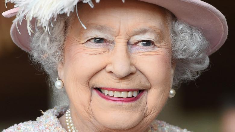 queen elizabeth feathered pink top hat