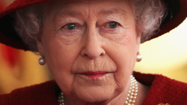 Queen Elizabeth with a serious expression
