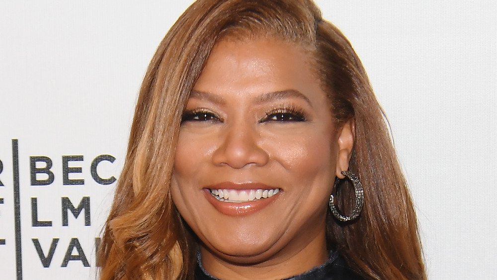Queen Latifah smiling on the red carpet