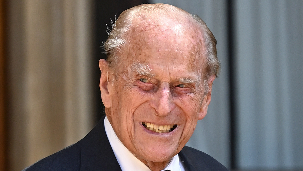 Prince Philip outside smiling