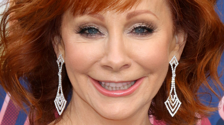 Reba McEntire smiling on the red carpet