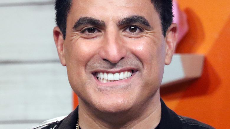 Reza Farahan smiling at camera