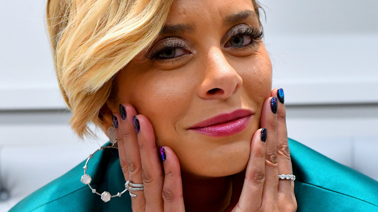 Robyn Dixon smiling at camera with hands on cheeks