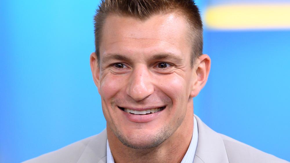 Rob Gronkowski smiles in light suit