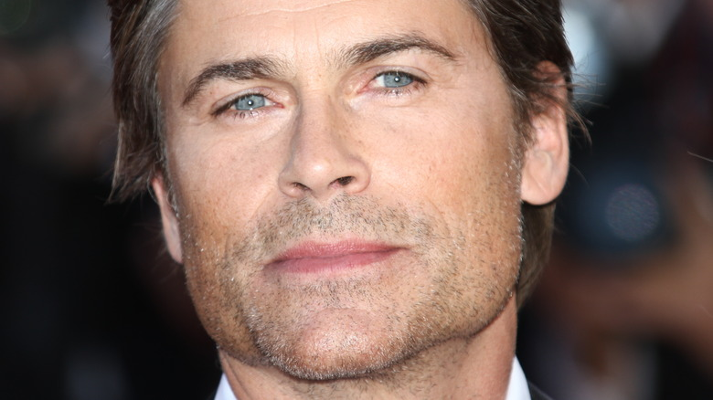 Rob Lowe with a serious expression