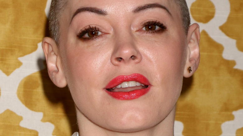 Rose McGowan with a neutral expression